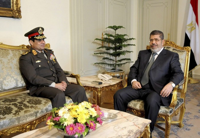 Egyptian Minister of Defense, Lt. Gen. Abdel-Fattah el-Sissi, left, meets with Egyptian President Mohammed Morsi at the presidential headquarters in Cairo, Egypt, Thursday, February 21, 2013.(AP Photo/Mohammed Abd El Moaty, Egyptian Presidency, File)